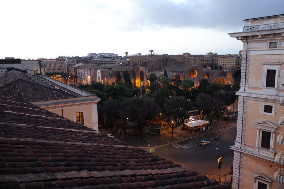 Photo -  The view of Rome from the Hotel Nord's rooftop at sundown. (Photo by Tricia Tramel)