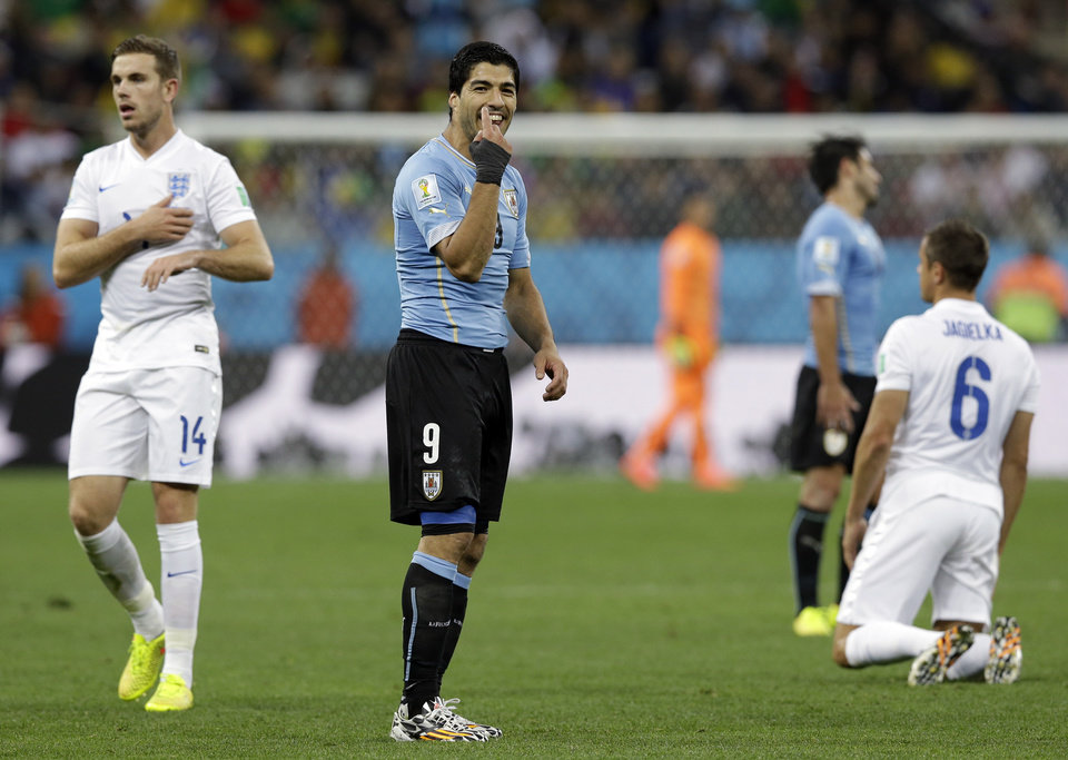 Photo - Uruguay's Luis Suarez gestures during the group D World Cup soccer match between Uruguay and England at the Itaquerao Stadium in Sao Paulo, Brazil, Thursday, June 19, 2014. (AP Photo/Thanassis Stavrakis)