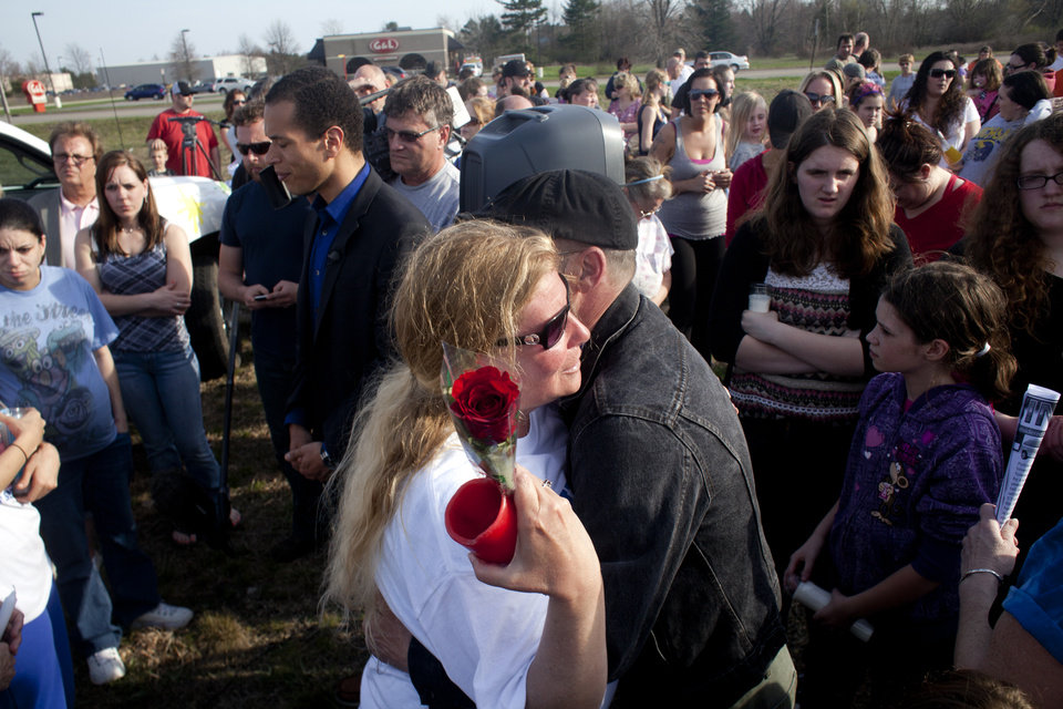 Marvin Gannon hugs Shelly Heeringa, mother of 25-year-old Jessica Heeringa during a vigil at Pointes Mall in Norton Shores, Mich. Jessica Heeringa was allegedly abducted at about 11 p.m. on Friday, April 26, 2013 from the Exxon Mobil gas station at 1196 E. Sternberg Road, where she worked as a night clerk. Hundreds gathered at the mall, close to where Heeringa worked, to light candles, show support to her family, and pray for her well being. (AP Photo/The Muskegon Chronicle, Jon Garcia) ALL LOCAL TV OUT; LOCAL TV INTERNET OUT