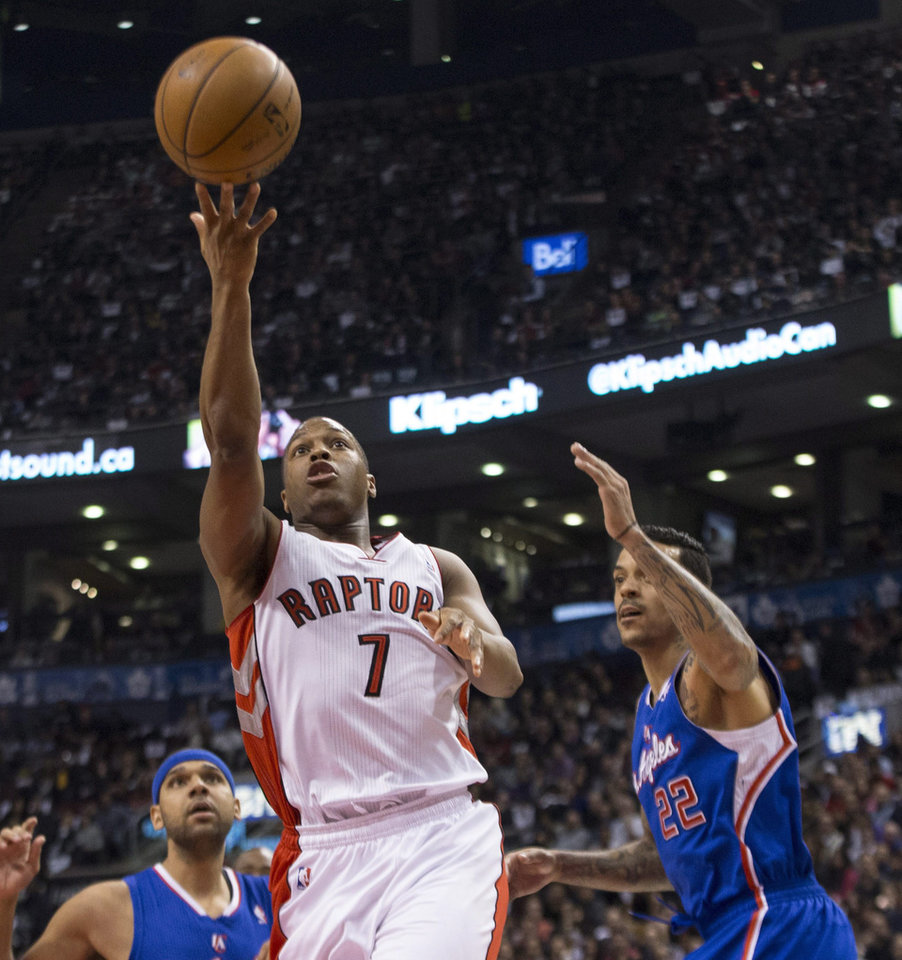 Photo - Toronto Raptors' Kyle Lowry drives through the Los Angeles Clippers defense to shoot during the first half of an NBA basketball game, Saturday, Jan. 25, 2014 in Toronto. (AP Photo/The Canadian Press, Chris Young)