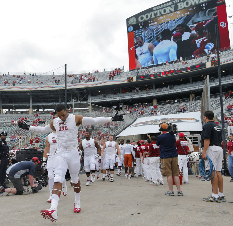 The Sooners make their way onto the field for warm ups during the Red River Rivalry college football game between the University of Oklahoma (OU) and the University of Texas (UT) at the Cotton Bowl in Dallas, Saturday, Oct. 13, 2012. Photo by Chris Landsberger, The Oklahoman