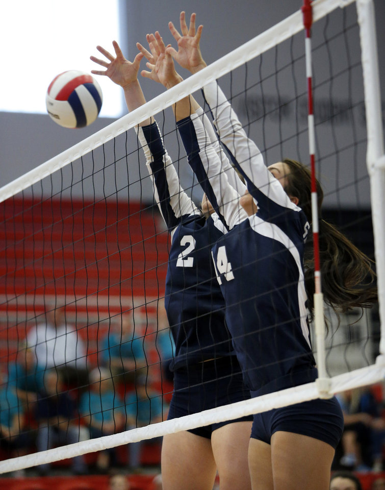 Shawnee's Tiffany Gardner (2) and Taylor Britt (14) block a shot as their team plays Booker T. Washington during the Class 5A State Championship volleyball tournament on Friday, Oct. 12, 2012, in Moore, Okla.  Photo by Steve Sisney, The Oklahoman