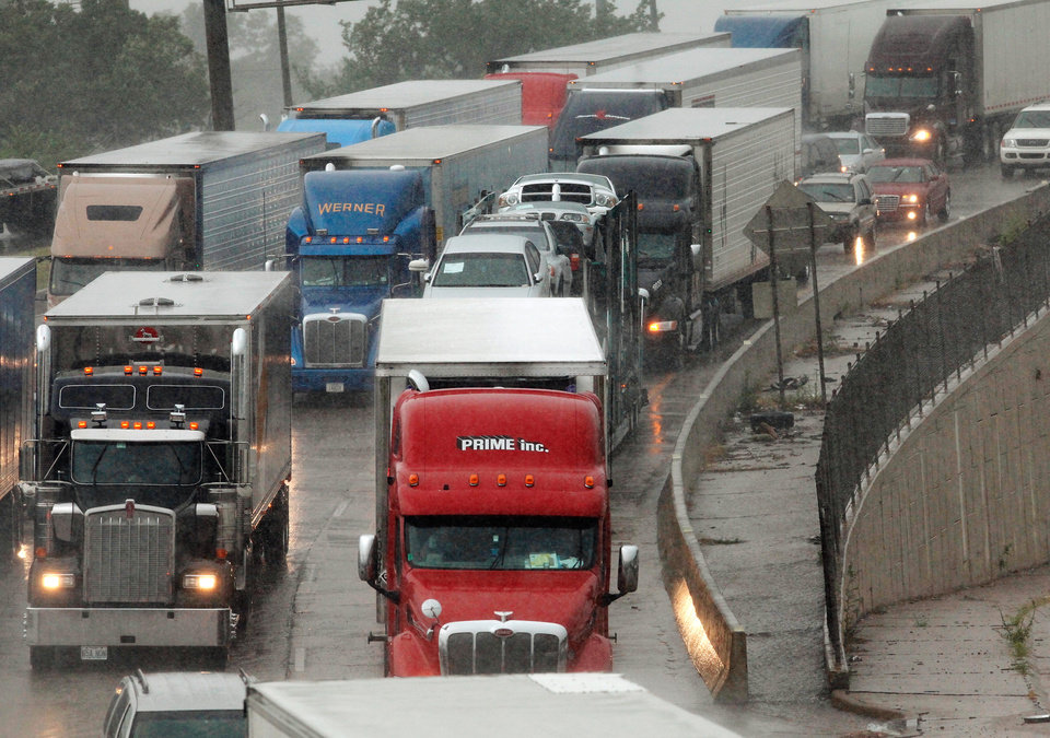 Photo - FLASH FLOODS / TORRENTIAL RAIN / FLOOD / FLOODING / INTERSTATE 44: Cars and trucks are stopped in eastbound lanes of I-44 near the Belle Isle Bridge. Torrential rain caused flooding in Oklahoma City, Monday, June 14, 2010.     by Jim Beckel, The Oklahoman ORG XMIT: KOD