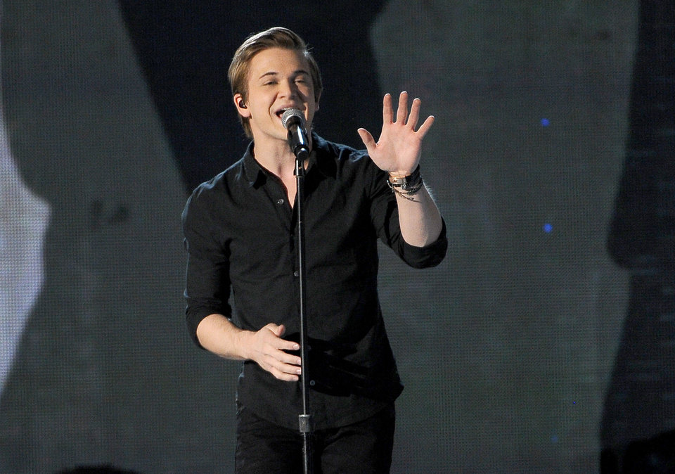 Photo - Hunter Hayes performs on stage at the 49th annual Academy of Country Music Awards at the MGM Grand Garden Arena on Sunday, April 6, 2014, in Las Vegas. (Photo by Chris Pizzello/Invision/AP)