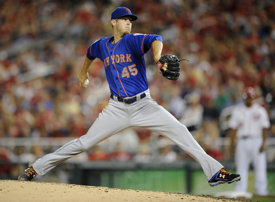 Photo - New York Mets starting pitcher Zack Wheeler delivers to the Washington Nationals during the fifth inning of a baseball game, Tuesday, Aug. 5, 2014, in Washington. (AP Photo/Nick Wass)