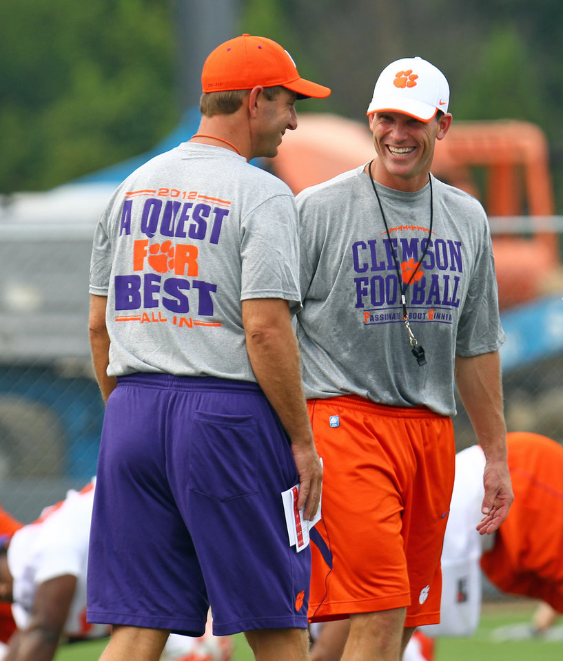 Clemson coach Dabo Swinney, left, talks with defensive coordinator Brent Venables. Venables has had plenty to say about Clemson\'s defensive failings in the Orange Bowl against West Virginia. On Saturday, he\'ll have a chance to make a statement when Clemson faces Auburn in Atlanta. (AP Photo/Anderson Independent-Mail, Mark Crammer).