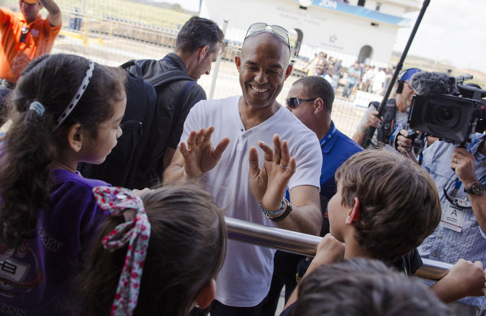 Photo - Mariano Rivera former New York Yankees baseball great, talks to children during a visit to the Miraflores Locks at the Panama Canal in Panama City, Friday, March 14, 2014. The New York Yankees and the Miami Marlins will play on March 15-16, in the