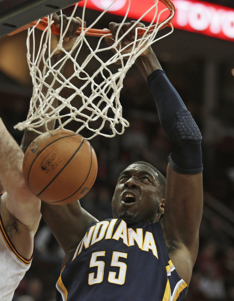 Indiana Pacers' Roy Hibbert (55) dunks the ball during the first quarter of an NBA basketball game against the Cleveland Cavaliers, Friday, Dec. 21, 2012, in Cleveland. Hibbert scored a team-high 18 points for the Pacers' 99-89 win. (AP Photo/Tony Dejak)