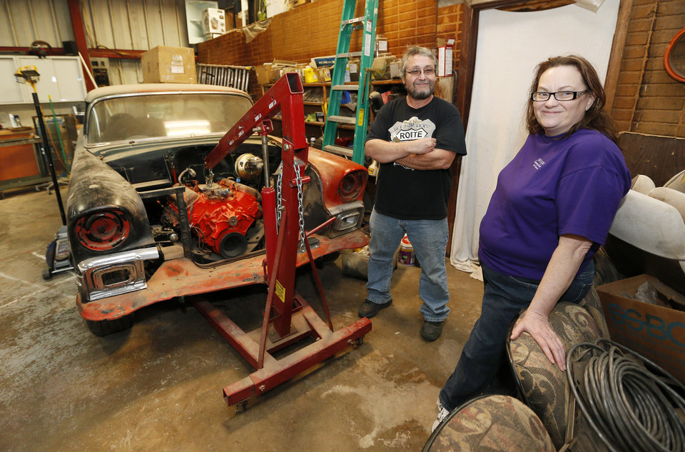 Photo - Green Acres owners Cody Shannon and Becky Shannon in Cody's garage with a 1956 Chevy Nomad at Green Acres.  NATE BILLINGS - The Oklahoman