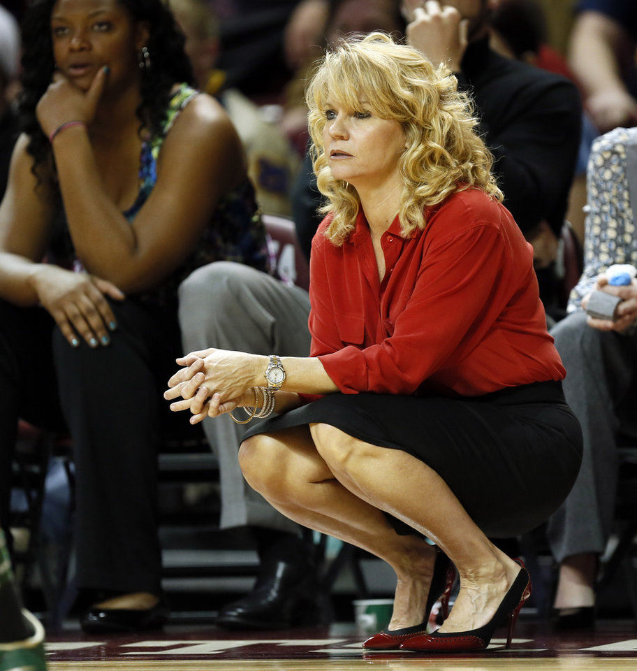Photo - OU coach Sherri Coale watches from the bench area during a women's college basketball game between the University of Oklahoma and Baylor at the Lloyd Noble Center in Norman, Okla., Monday, Feb. 25, 2013. Baylor beat OU, 86-64. Photo by Nate Billings, The Oklahoman