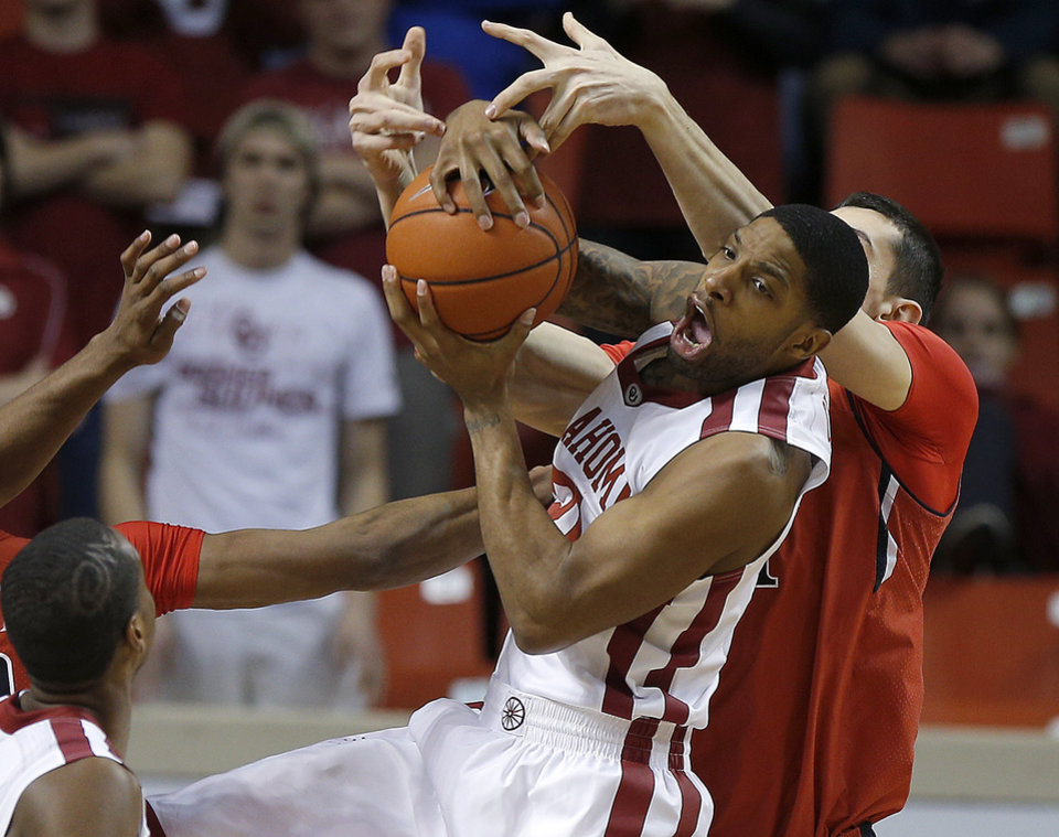 Photo - Oklahoma's Cameron Clark (21) grabs of in front of Texas Tech's Dejan Kravic (11) during an NCAA college basketball game between the University of Oklahoma and Texas Tech University at the Lloyd Noble Center in Norman, Okla., Wednesday, Feb. 12, 2014. Oklahoma lost 68-60. Photo by Bryan Terry, The Oklahoman