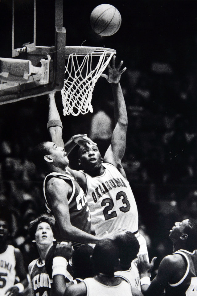 Former OU basketball player Wayman Tisdale. Sam Hill can\'t keep Wayman Tisdale from collecting two of his 33 points. Staff photo by Doug Hoke. Photo taken 2/13/1985, photo published 2/14/1985 in The Daily Oklahoman. ORG XMIT: KOD
