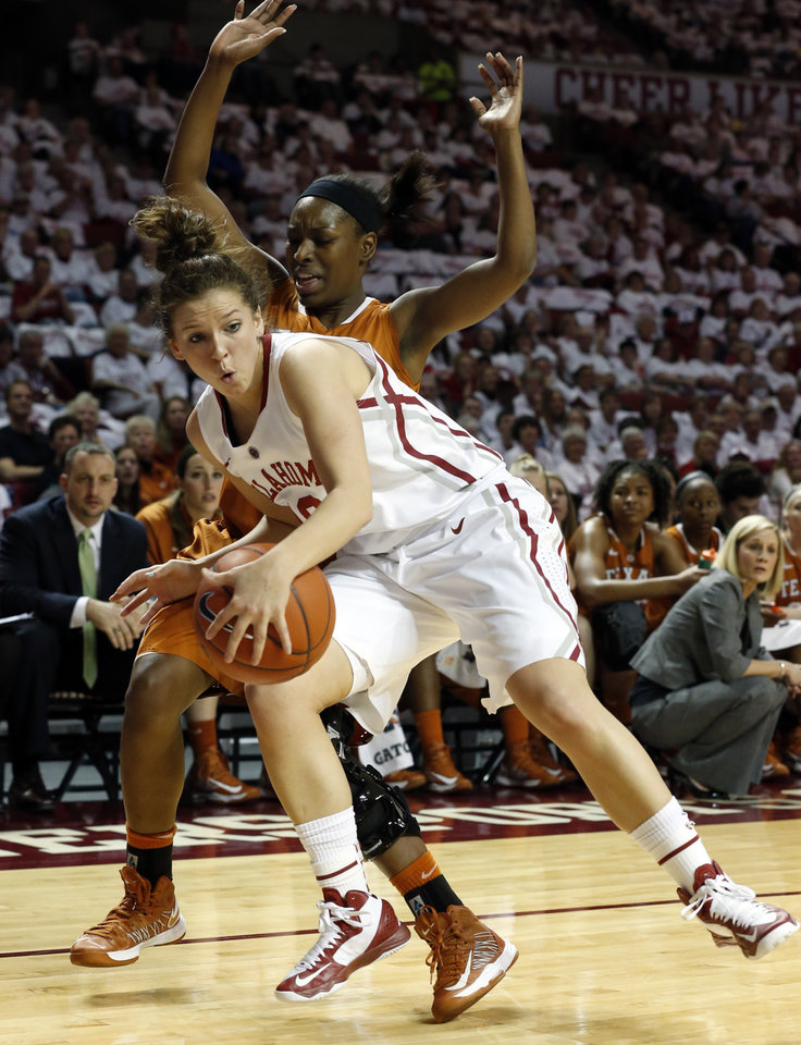 Photo - Oklahoma Sooners' Morgan Hook (10) fights for a rebound in front of Texas Longhorn's Nneka Enemkpali (3) as the University of Oklahoma Sooners (OU) play the University of Texas (UT) Longhorns in NCAA, women's college basketball at The Lloyd Noble Center on Saturday, Jan. 19, 2013 in Norman, Okla. Photo by Steve Sisney, The Oklahoman