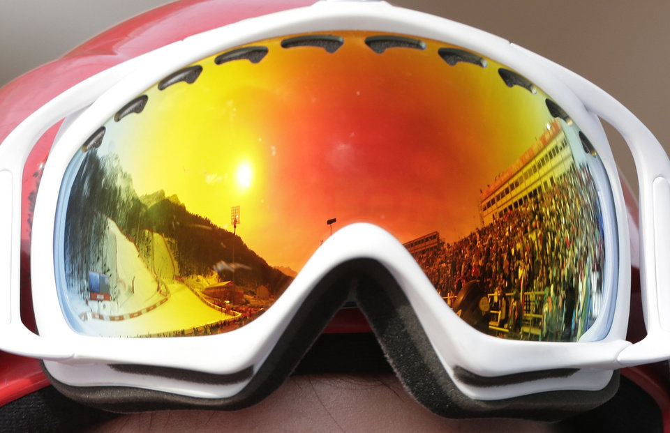 Photo - The Alpine ski course is reflected in a skier's goggles during the men's super-G at the Sochi 2014 Winter Olympics, Sunday, Feb. 16, 2014, in Krasnaya Polyana, Russia. (AP Photo/Charlie Riedel)