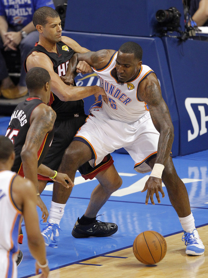 Oklahoma City\'s Kendrick Perkins (5) battles against Miami\'s Shane Battier (31) during Game 2 of the NBA Finals between the Oklahoma City Thunder and the Miami Heat at Chesapeake Energy Arena in Oklahoma City, Thursday, June 14, 2012. Photo by Chris Landsberger, The Oklahoman