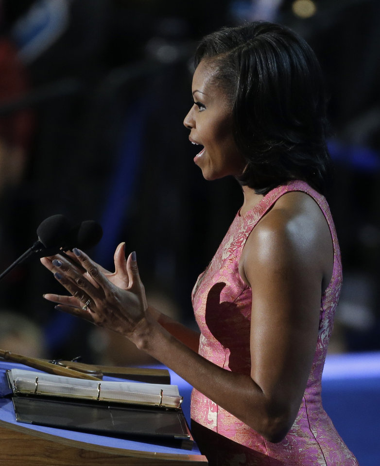 Photo - First Lady Michelle Obama speaks to delegates at the Democratic National Convention in Charlotte, N.C., on Tuesday, Sept. 4, 2012. (AP Photo/Lynne Sladky)  ORG XMIT: DNC527