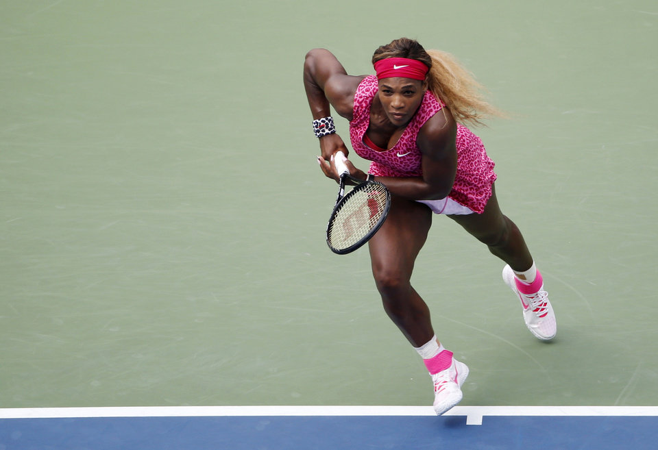 Photo - Serena Williams, of the United States, chases down shot against Kaia Kanepi, of Estonia, during the fourth round of the 2014 U.S. Open tennis tournament, Monday, Sept. 1, 2014, in New York. (AP Photo/Seth Wenig)