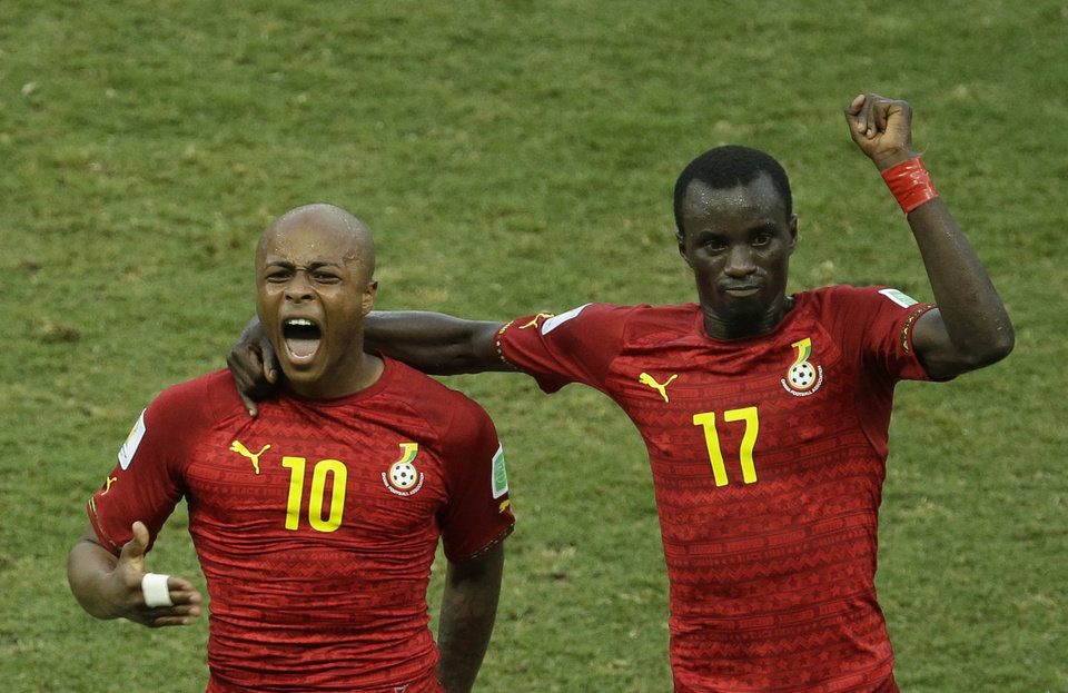 Photo - Ghana's Andre Ayew, left, celebrates with his teammate Mohammed Rabiu after scoring his side's first goal during the group G World Cup soccer match between Germany and Ghana at the Arena Castelao in Fortaleza, Brazil, Saturday, June 21, 2014. (AP Photo/Themba Hadebe)