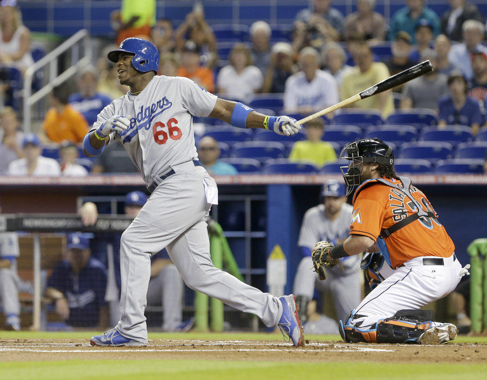 Photo - Los Angeles Dodgers' Yasiel Puig (66) reacts after striking out during the first inning of a baseball game against the Miami Marlins, Sunday, May 4, 2014, in Miami. (AP Photo/Wilfredo Lee)