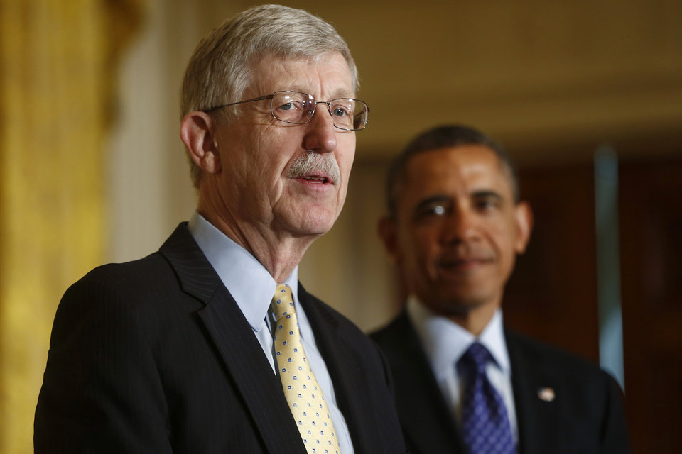 Photo - President Barack Obama listens as National Institutes of Health (NIH) Director Francis S. Collins speaks about the BRAIN (Brain Research through Advancing Innovative Neurotechnologies) Initiative, Tuesday, April 2, 2013, in the East Room at the White House in Washington. (AP Photo/Charles Dharapak)