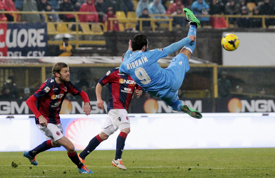 Photo - Napoli's Gonzalo Higuain goes for an acrobatic kick during a Serie A soccer match between Bologna and Napoli at the Renato Dall'Ara stadium in Bologna, Italy, Sunday, Jan. 19, 2014. (AP Photo/Studio FN)
