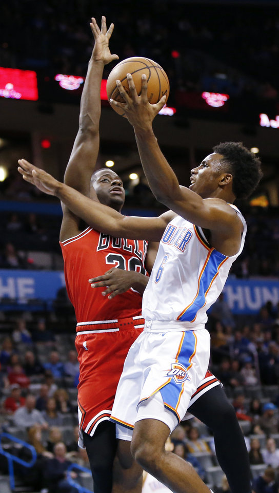 Photo - Oklahoma City's Hamidou Diallo (6) tries to score against Chicago's Rawle Alkins (20) during an NBA basketball game between the Chicago Bulls and the Oklahoma City Thunder at Chesapeake Energy Arena in Oklahoma City, Monday, Dec. 17, 2018. Oklahoma City won 121-96. Photo by Nate Billings, The Oklahoman