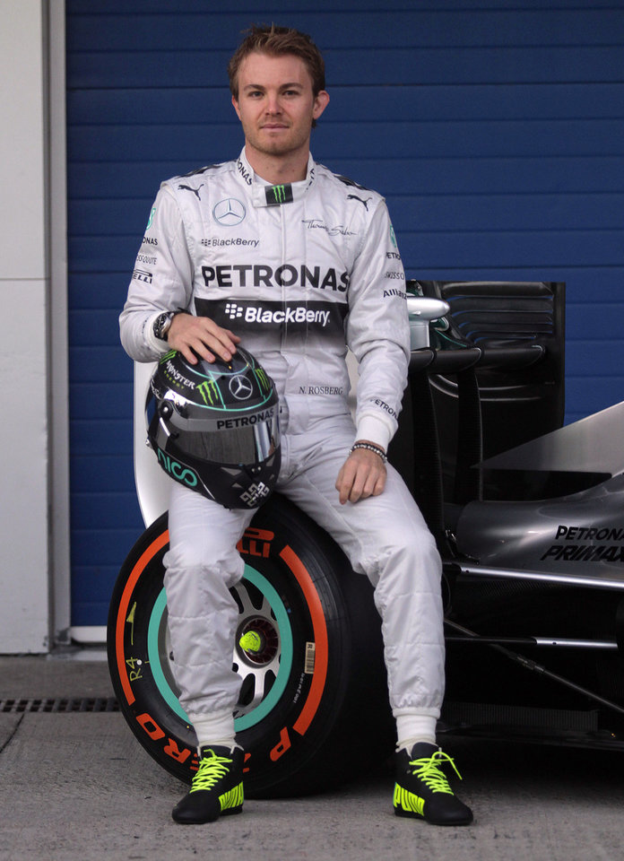 Photo - Mercedes GP driver Nico Rosberg of Germany attends the launch of his new Mercedes W05 Formula One car at the Circuito de Jerez on Tuesday, Jan. 28, 2014, in Jerez de la Frontera, Spain. (AP Photo/Miguel Angel Morenatti)
