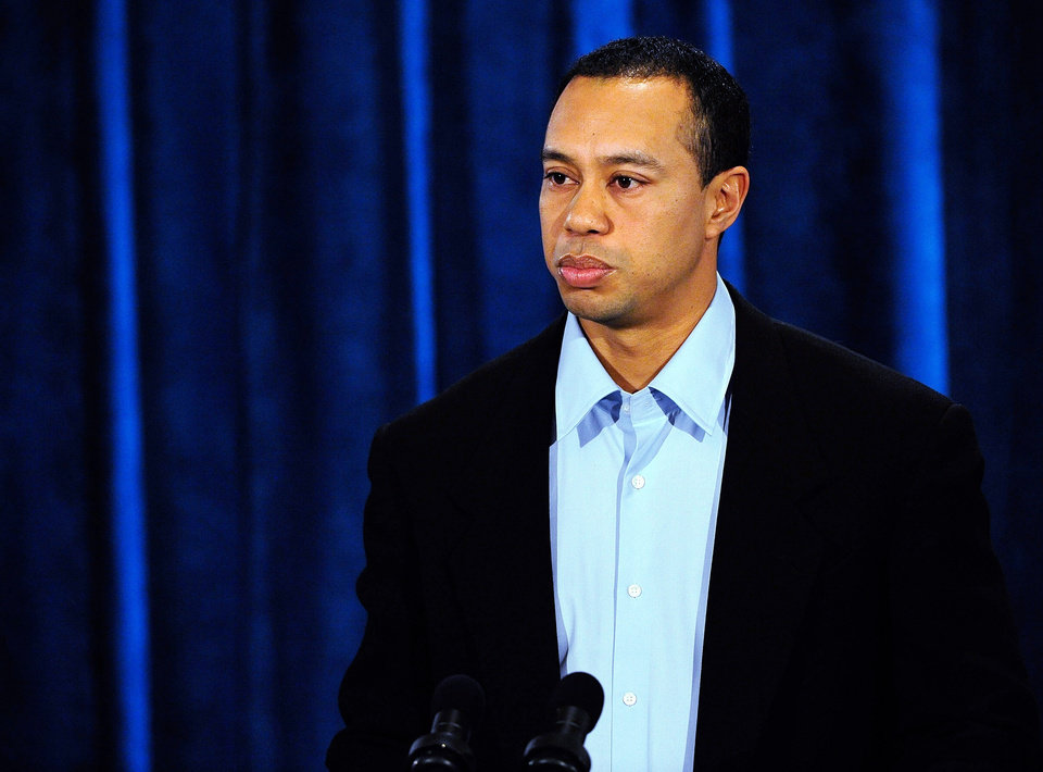 Photo - Tiger Woods makes a statement at the Sawgrass Players Club, Friday, Feb. 19, 2010, in Ponte Vedra Beach, Fla. (AP Photo/Sam Greenwood, Pool) ORG XMIT: TWP119