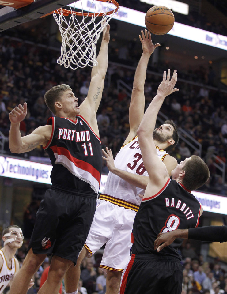 Photo - Cleveland Cavaliers' Omri Casspi (36), from Israel, shoots over Portland Trail Blazers' Meyers Leonard (11) and Luke Babbitt (8) in the second quarter of an NBA basketball game Saturday, Dec. 1, 2012, in Cleveland. (AP Photo/Tony Dejak)