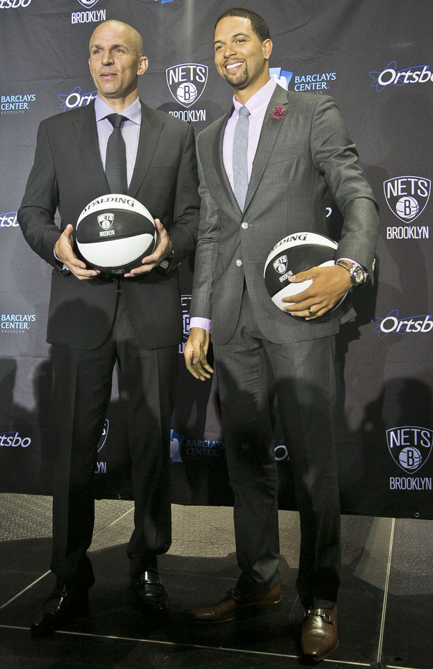 Photo - Brooklyn Nets new coach Jason Kidd, left, and star guard Deron Williams pose after an NBA basketball news conference introducing Kidd Thursday, June 13, 2013, in New York. (AP Photo/Bebeto Matthews)