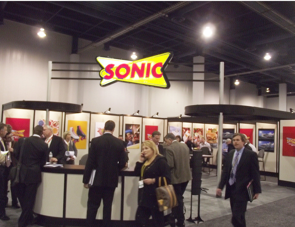 Photo - Oklahoma City-based Sonic's booth is shown at the International Council of Shopping Centers conference this week in Las Vegas.