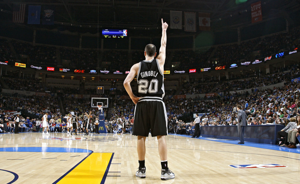 The Spurs' Manu Ginobili (20) signals a play from the back court during the first half of the NBA basketball game between the Oklahoma City Thunder and the San Antonio Spurs at the Ford Center on Monday, March 22, 2010, in Oklahoma City, Okla.  Photo by Chris Landsberger, The Oklahoman