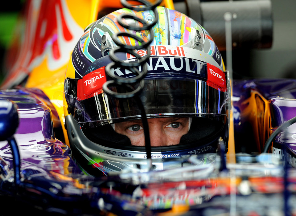 Photo - Germany's Sebastian Vettel of Red Bull Racing sits in his car during first practice session before the Formula One British Grand Prix at Silverstone, England, on Friday, July 4, 2014. The British Formula One Grand Prix will be held on Sunday July 6, 2014. (AP Photo/Rui Vieira)