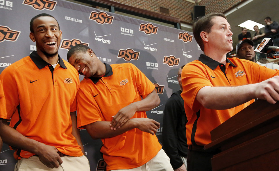 Marcus Smart leans onto teammate Markel Brown as they both break into laughter while their coach, Travis Ford, talks about next year\'s season. OSU basketball players Le\'Bryan Nash, Markel Brown and Marcus Smart delighted fans when they announced at a noontime press conference they intend to return for another season as members of the Cowboys basketball team. Cheering fans lined all levels in the Student Union atrium Wednesday, April 17, 2013. by Jim Beckel, The Oklahoman.