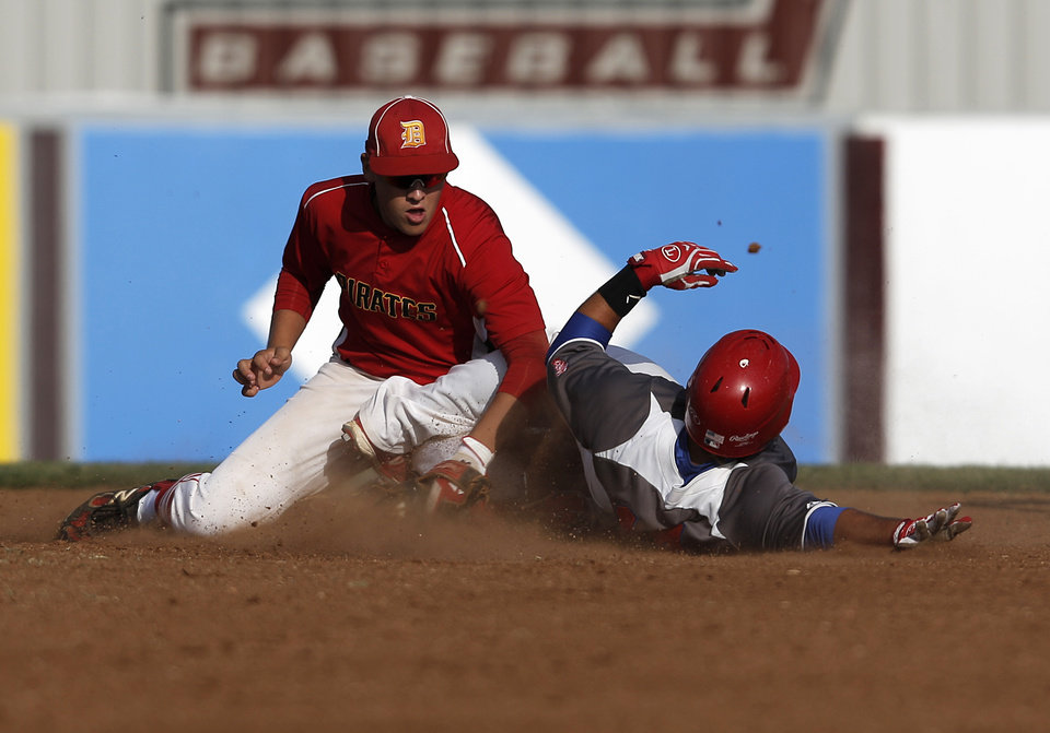 Dale's Chase Byndas (2) tags Silo's Kyle Tate (14) during the Class A State Baseball semifinal game between Dale and Silo in Edmond, Okla., Friday, Oct. 5, 2012.  Photo by Garett Fisbeck, The Oklahoman