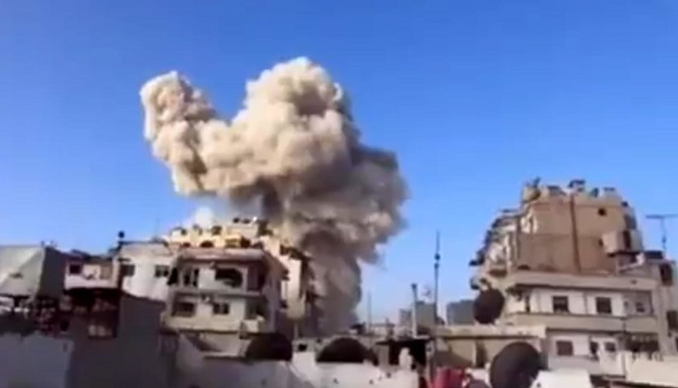 Photo - In this image taken from video obtained from the Ugarit News, which has been authenticated based on its contents and other AP reporting, smoke leaps the air from a building after a warplane attack in Homs, Syria, on Wednesday, Nov. 28, 2012. (AP Photo/Ugarit News via AP video)