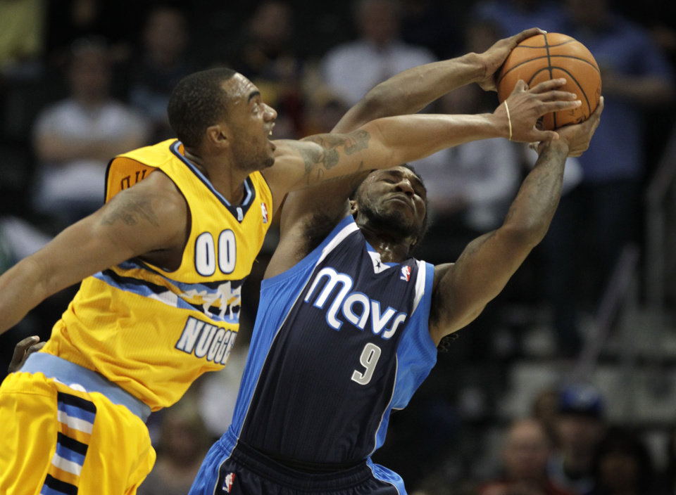Photo - Denver Nuggets forward Darrell Arthur (00) challenges Dallas Mavericks forward Jae Crowder (9) to a rebound in the first quarter of an NBA game in Denver on Wednesday, March 5, 2014.(AP Photo/Joe Mahoney)