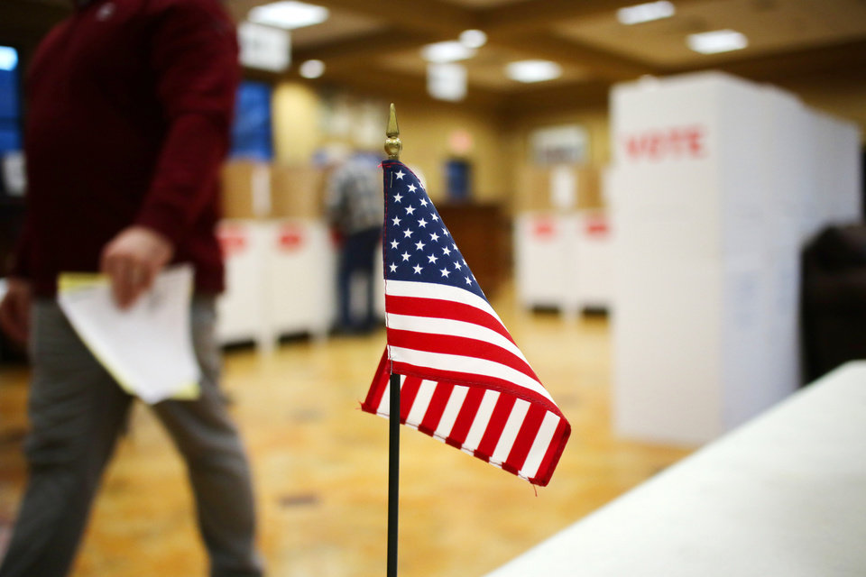 Photo - Voters cast their ballots in the Edmond race in Ward 3 Monday, February 11, 2019.  Photo by Doug Hoke/The Oklahoman