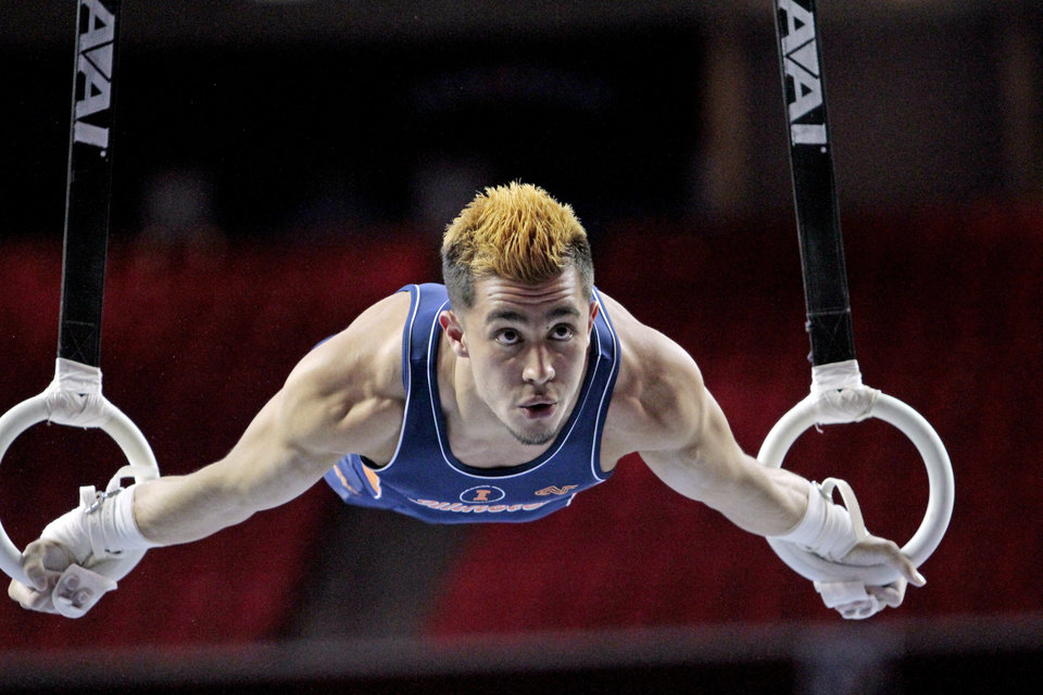 Photo - Illinois' C. J. Maestas competes in the rings at the event finals of the men's NCAA Men's Gymnastics Championships at the Lloyd Noble Center on Saturday, April 21, 2012, in Norman, Okla.  (AP PHOTO/The Oklahoman, Steve Sisney)