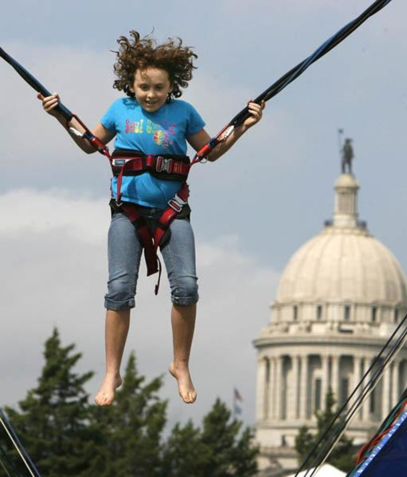 Photo -  Eight-year-old Danielle Dodd flies high during Septemberfest at the Governor's Mansion in Oklahoma City, OK, Saturday, Sept. 6, 2008. BY PAUL HELLSTERN, THE OKLAHOMAN