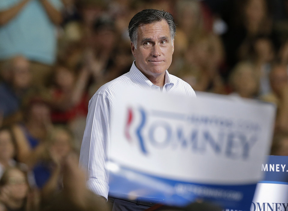 Photo -   Republican presidential candidate and former Massachusetts Gov. Mitt Romney pauses as supporters cheer to remarks during a rally Friday, Sept. 21, 2012, in Las Vegas. (AP Photo/Julie Jacobson)