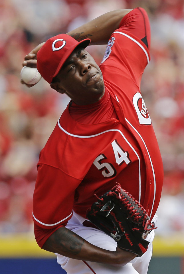 Photo - Cincinnati Reds relief pitcher Aroldis Chapman throws against the Colorado Rockies in the ninth inning of a baseball game, Sunday, May 11, 2014, in Cincinnati. Chapman earned his first save of the year as the Reds won 4-1. Chapman was making his first appearance since being hit in the head with a line drive in spring training. (AP Photo/Al Behrman)