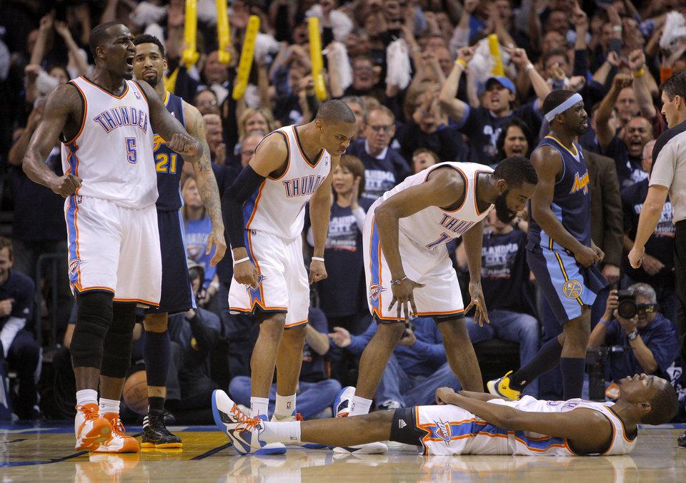 Photo - Oklahoma City's Kendrick Perkins (5), Russell Westbrook (0), Kevin Durant (35), and  James Harden (13) celebrate beside Denver's Wilson Chandler (21) and Ty Lawson (3) after Durant was fouled while making a basket during the NBA basketball game between the Denver Nuggets and the Oklahoma City Thunder in the first round of the NBA playoffs at the Oklahoma City Arena, Wednesday, April 27, 2011. Photo by Bryan Terry, The Oklahoman