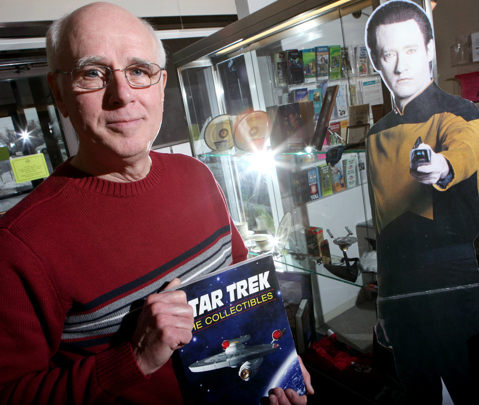 Photo - STAR TREK COLLECTION / COLLECT / COLLECTOR: Butch Roberts poses near an exhibit featuring items in his personal collection at the Choctaw Library on Wednesday, Dec. 30, 2009. By John Clanton, The Oklahoman ORG XMIT: KOD
