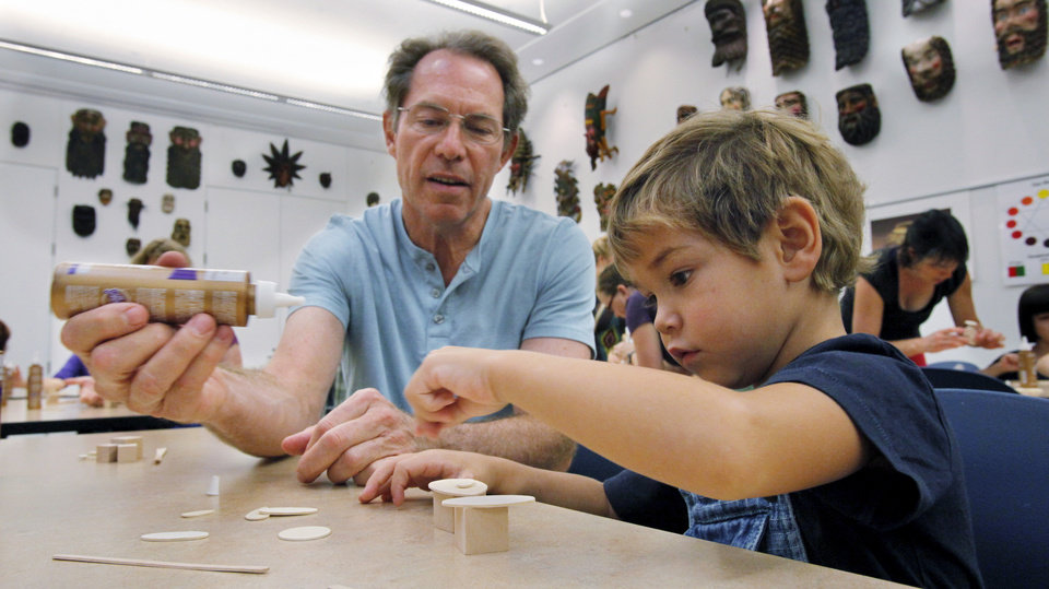 Photo - Paul Maenza and grandson Joseph Maenza work on their art project during Art Adventures at the Fred Jones Jr. Museum of Art on the campus of the University of Oklahoma (OU) on Tuesday, Sept. 18, 2012 in Norman, Okla.  Photo by Steve Sisney, The Oklahoman