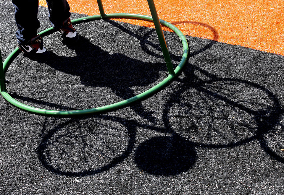 Photo - Shadow cast by a boy shooting a basketball into one of several nets on a stand in the 'Stars of the Future' area north of Boone Pickens Stadium on the campus of Oklahoma State University on Thursday, May 15, 2014.  Special Olympics athletes numbering in the thousands are competing in various events today and tomorrow  in Stillwater as the organization's 45th Annual Summer Games are held in Oklahoma this week.  Officials say more than 4,600 Special Olympics Oklahoma athletes have registered to compete this year, and thousands of volunteers are assisting during the three days of competitions.   This is the 31st year the summer games has been centered at Oklahoma State University.  Special Olympics is the world's largest sports organization for children and adults with intellectual disabilities, providing year-round training and competitions to more than 4.2 million athletes in 170 countries, according to their web site. Photo by Jim Beckel, The Oklahoman
