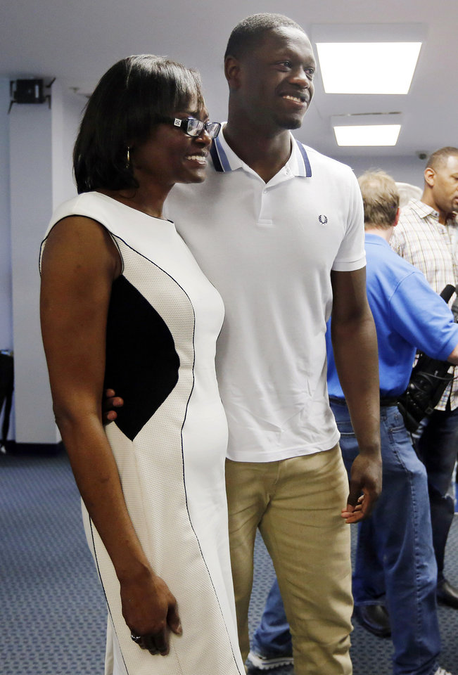 Photo - Kentucky's Julius Randle, right, poses with his mother Carolyn Kyles after Randle announced he will enter his name in the NBA draft during a news conference in Lexington, Ky., Tuesday, April 22, 2014. (AP Photo/James Crisp)
