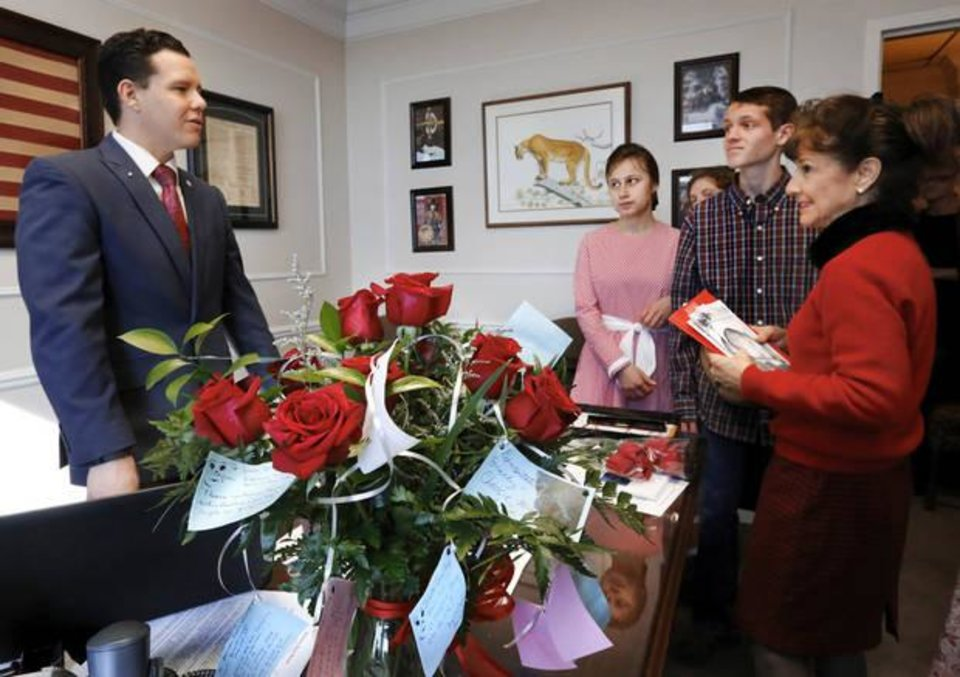 Photo - In this Feb. 8, 2017 photo, a group of sanctity-of-life advocates from Seminole visit Sen. Jason Smalley after delivering flowers to his office during Rose Day activities at the state Capitol. [ Photo by Jim Beckel, The Oklahoman]