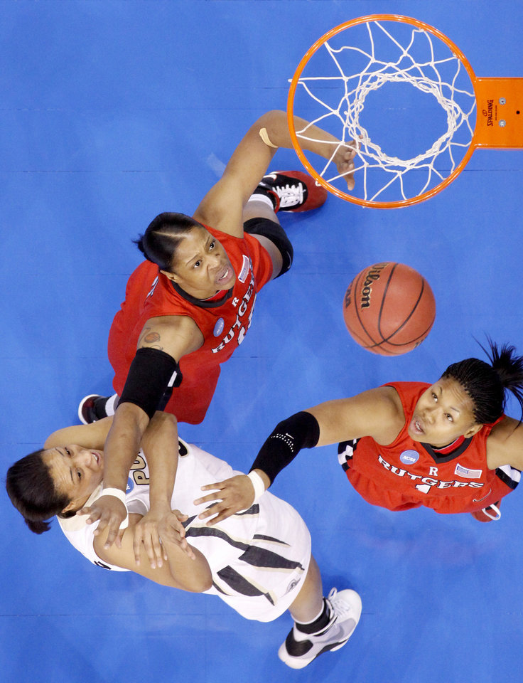 Purdue's Lindsay Wisdom-Hylton scores a basket between Rutgers' Kia Vaughn, left, and Khadijah Rushdan during the NCAA women's basketball tournament game between Rutgers and Purdue at the Ford Center in Oklahoma City, Sunday, March 29, 2009.  PHOTO BY BRYAN TERRY, THE OKLAHOMAN