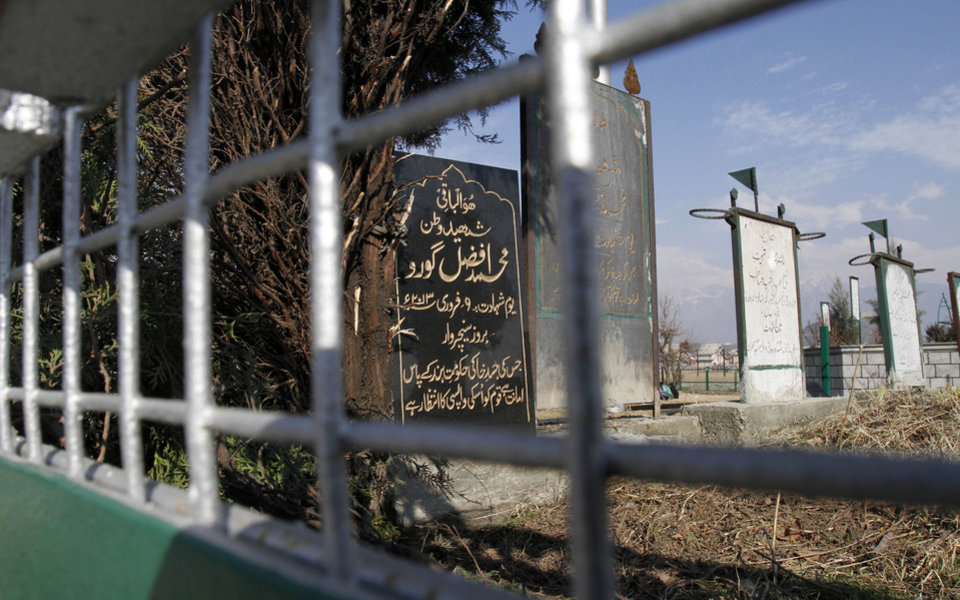 "A tombstone put up by unknown residents marks an empty grave for Mohammed Afzal Guru, the Kashmiri man executed Saturday morning, in the main martyr's graveyard in Srinagar, India, Tuesday, Feb. 12, 2013. Separatist politicians called for a mass funeral prayer for Guru, convicted in a deadly attack on India's Parliament, to be held Friday at a large square near Srinagar's Martyr's Graveyard, where hundreds of separatists and civilians killed in the conflict are buried. The epitaph reads: ""His mortal remains are lying in trust with the government of India. Kashmiri nation awaits its return."" (AP Photo/ Mukhtar Khan)"